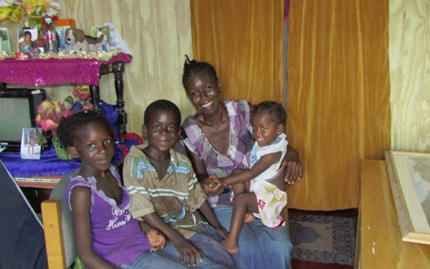 Denise with her children in her new home